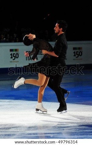 TURIN, ITALY - MARCH 28: Professional Italian skaters Federica FAIELLA & Massimiliano SCALI perform final Gala during the 2010 World Figure Skating Championship on March 28, 2010 in Turin, Italy.