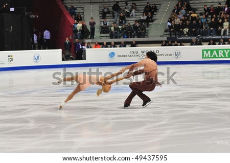 TURIN, ITALY - MARCH 23: Professional Russian skaters Maria MUKHUTOVA Maxim TRANKOV perform Pair short program during the 2010 World Figure Skating Championship on March 23, 2010 in Turin, Italy. - stock photo