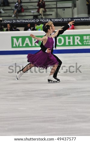 TURIN, ITALY - MARCH 23: Professional USA skaters Meryl DAVIS Charlie WHITE perform Golden waltz during the 2010 World Figure Skating Championship on March 23, 2010 in Turin, Italy.