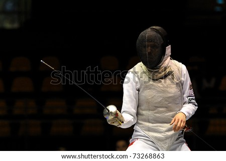 TURIN, ITALY - MARCH 13: Unknown Poland athlete stands on ward during team tournament final match of the 2011 Women world fencing cup on March 13, 2011 in Turin, Italy - stock photo