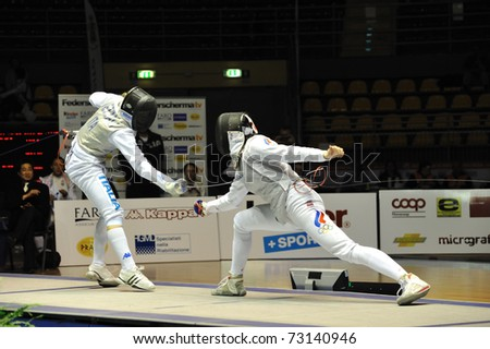 TURIN, ITALY - MARCH 13: Valentina VEZZALI (ITA) fight against Aida SHANAEVA (RUS) during team tournament final match of the 2011 Women world fencing cup on March 13, 2011 in Turin, Italy - stock photo