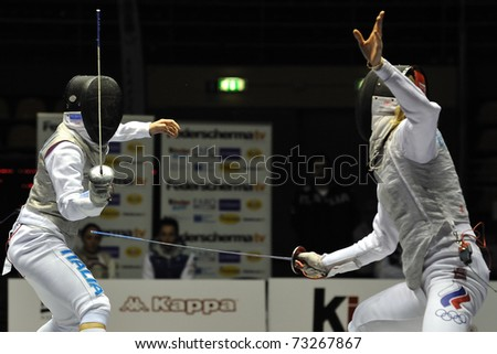 TURIN, ITALY - MARCH 13: Valentina VEZZALI (ITA) fight closeup against Inna DERIGLAZOVA (RUS) during team tournament final match of the 2011 Women world fencing cup on March 13, 2011 in Turin, Italy - stock photo