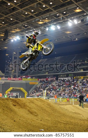 TURIN, ITALY - OCTOBER 01: Bergonazani Ivan on Suzuky SX2 competes at Supercross SX series, on October 01, 2011 in Turin, Italy. SX Series is an important European indoor motocross championship. - stock photo