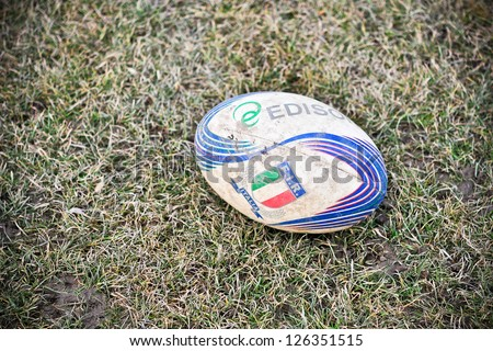 TURIN - JANUARY 27: Ball on the field during the rugby match between Cus Torino and Amatori Parma, on January 27, 2013 Turin, Italy. - stock photo