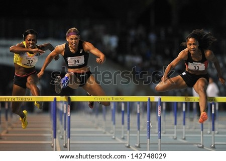 TURIN - JUNE 8: (from left) Porter Tiffany, Lolo Jones, Harrison Queen run 110m hurdles woman race at XIX Turin International Track and Field meeting, Italy on 8th june 2013, in Turin, Italy. - stock photo