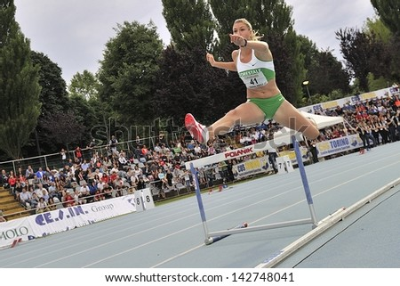 TURIN - JUNE 8: Giulia Latini from Italy runs 400m hurdles women at XIX Turin International Track and Field meeting in Turin, Italy on 8th june 2013, in Turin, Italy. - stock photo