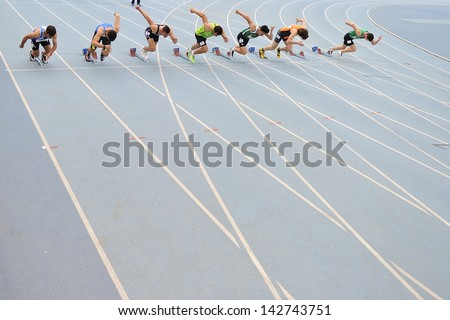TURIN - JUNE 8:Many unknown athlete start for 100m sprint U19 category race at XIX Turin International Track and Field meeting in Turin, Italy on 8th june 2013, in Turin, Italy. - stock photo
