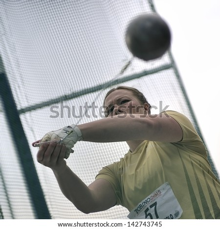 TURIN - JUNE 8:Novozhilova Iryna from Ukraina performs Hammer Throw at XIX Turin International Track and Field meeting in Turin, Italy on 8th june 2013, in Turin, Italy. - stock photo