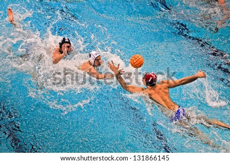 TURIN - MARCH 16: Attack of unidentified player of Torino81 team during the water polo match between Torino81 and Lavagna90, on March 16, 2013 Turin, Italy. - stock photo