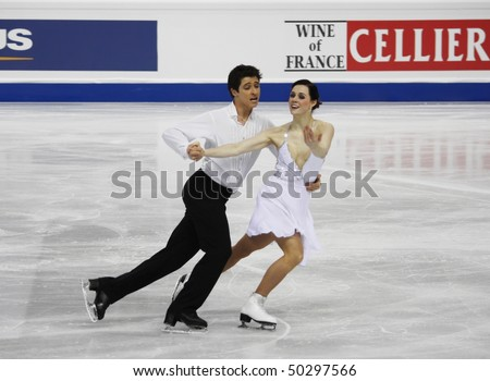 TURIN - MARCH 26: Tessa Virtue and Scott Moir of Canada perform at the ISU World Figure Skating Championships held March 26, 2010 in Turin, Italy - stock photo