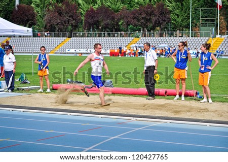 TURIN - MAY 12: Unidentified athlete jumping during the Italian Championships of Athletics for paralympic athletes on May 12, 2012 Turin, Italy.