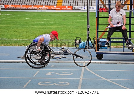 TURIN - MAY 12: Unidentified athlete on a wheelchair starting during the Italian Championships of Athletics for paralympic athletes on May 12, 2012 Turin, Italy. - stock photo