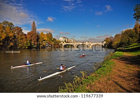 TURIN - NOVEMBER 11: Unidentified athletes  wait for the start of the traditional International long distance rowing regatta '��Silverskiffâ�' on November 11, 2012 Turin, Italy. - stock photo