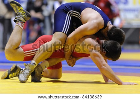TURIN - OCT 29: TUFENK Seref (TUR) fight against PALENSKI Valery during (BLR) Wrestling 2010 9th World University Championship, October 29, 2010 in Turin, Italy. - stock photo