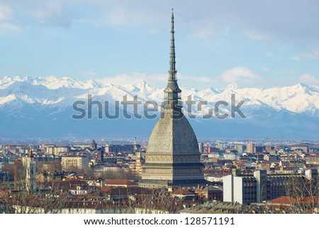 Turin panorama seen from the hill, with Mole Antonelliana (famous ugly wedding cake architecture) - stock photo