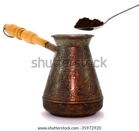 Turk and spoon with ground coffee
