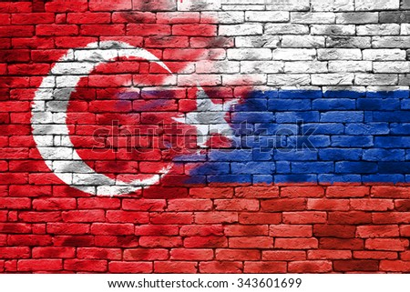 turkey and russia flag on retro brick wall background - stock photo