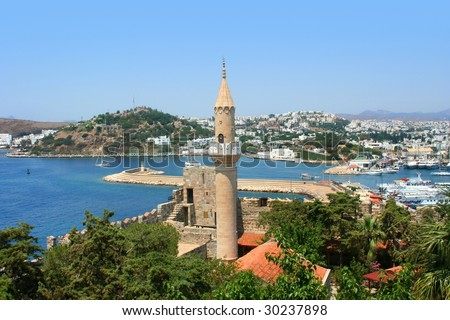 Turkey. Bodrum city.  The ancient name - Halikarnas. Castle of Saint Peter and islam mosque - stock photo
