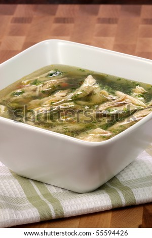 turkey breast and vegetables soup  made with low sodium  broth,  on fine wood table table. - stock photo