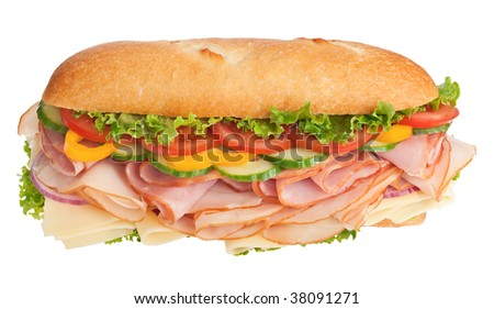 Turkey breast, ham & cheese sandwich topped with fresh veggies isolated on white - stock photo