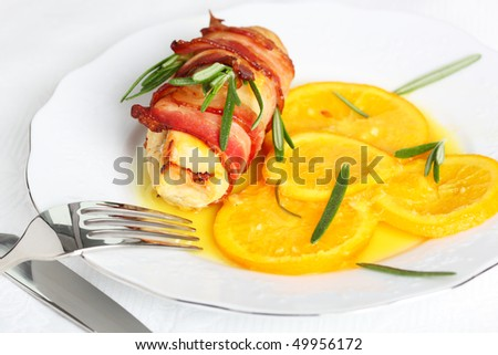 Turkey breast rolls (roulades) in bacon with orange sauce