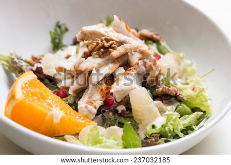 Turkey breast salad with walnut and pomelo on white background