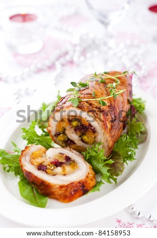 Turkey breast stuffed with cranberry,apricot and pistachio for Christmas - stock photo