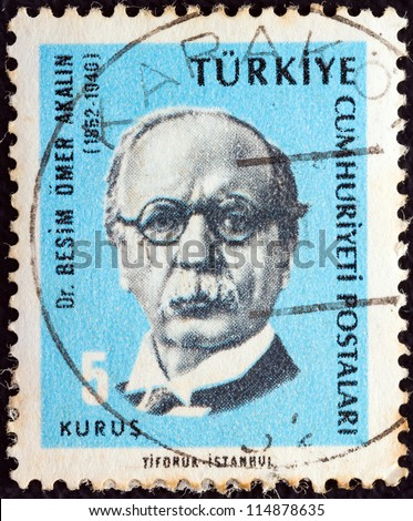 "TURKEY - CIRCA 1965: A stamp printed in Turkey from the ""Cultural Celebrities"" issue shows Dr. Besim Omer Akalin, circa 1965."