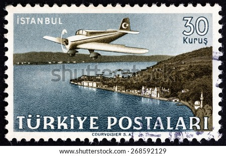 "TURKEY - CIRCA 1949: A stamp printed in Turkey from the ""Turkish Aircraft over Landscapes "" issue shows Curtiss-Wright CW-22 over Istanbul, circa 1949.  - stock photo"