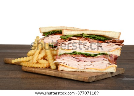 turkey club sandwich with fries - stock photo