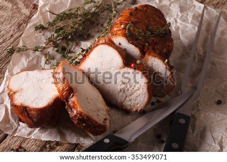 Turkey fillet roasted close-up paper on the table. horizontal - stock photo