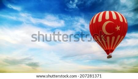 turkey flag hot air balloon flying blue sky with clouds - stock photo