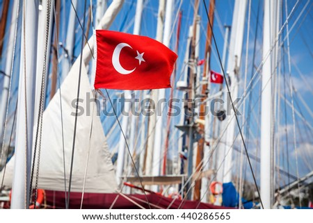 Turkey flag on the boat at hot sunny day in Bodrum Marina - stock photo