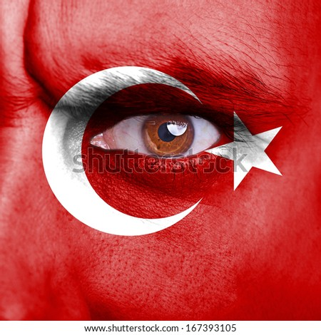 Turkey flag painted on angry man face - stock photo