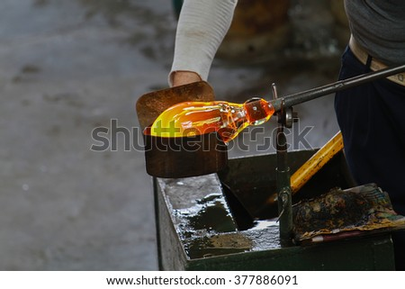 TURKEY - GAZ?ANTEP - August 02 2012:Glassblowing artisan at work in a crystal glass workshop . - stock photo