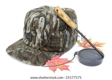Turkey hunter's hat and slate call. - stock photo