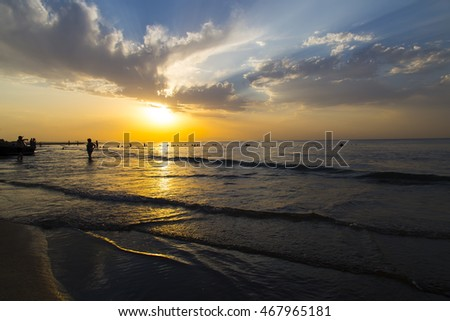 TURKEY ISTANBUL ; AUGUST 12, 2016, a beautiful sunset and people on the beach into the sea