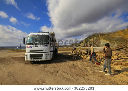 TURKEY - ISTANBUL January 13, 2011: Woodcutters truck loads of wood workers.
