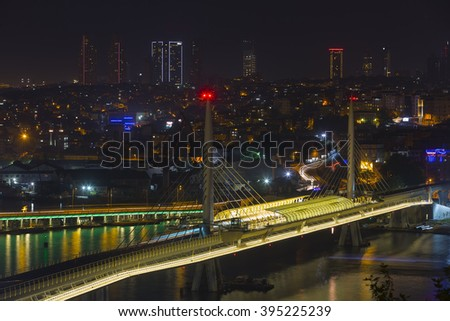 TURKEY - ISTANBUL, JULY 22, 2014; istanbul at night and metro bridge, mosques.