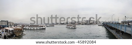 Turkey, Istanbul, panoramic view of the Golden Horn, the city and the Galata Bridge - stock photo