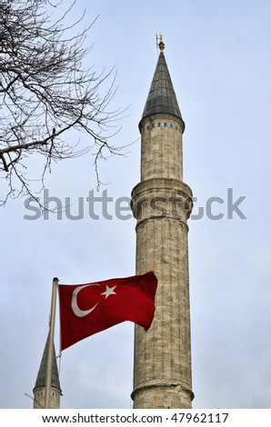 Turkey, Istanbul, turkish flag and St. Sophia Cathedral (built in the 4th century by Costantine the Great and reconstructed in the 6th century by Justinian) - stock photo