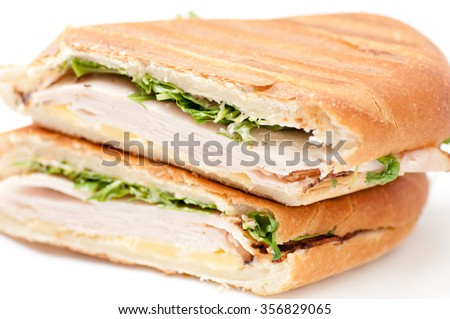 turkey panini with arugula and cheddar cheese