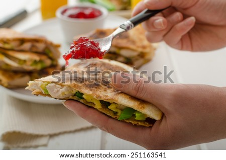 Turkey quesadillas with currant sauce, fresh orange juice, woman, preparing for eat - stock photo