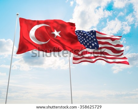 Turkey & United States of America Flags are waving in the spring of the blue sky. - stock photo