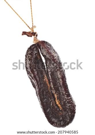Turkic  sausages sudzhuk isolated on white background - stock photo
