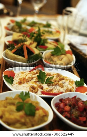 Turkish appetizer foods on the restaurant table in Istanbul, Turkey. - stock photo