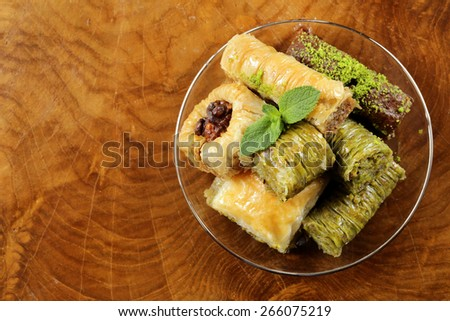 Turkish arabic dessert - baklava with honey and walnut, pistachios nuts - stock photo