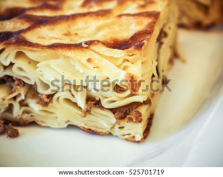 Turkish Borek called su boregi served on white plate