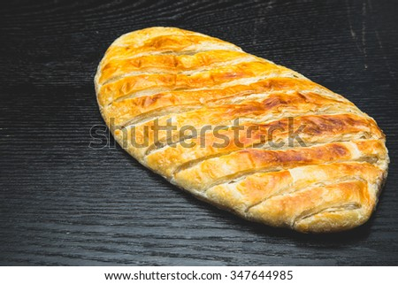 Turkish bread Katmer on a black wooden table or board. Selective focus. Shallow depth of field. Selective Focus. Toned. - stock photo