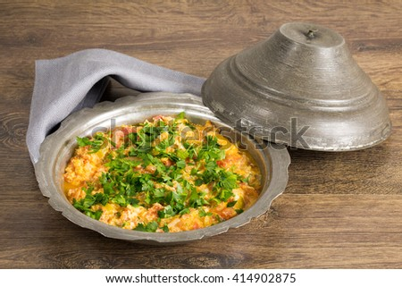 Turkish breakfast: omelet with vegetables in copper plate. - stock photo
